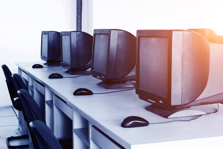 neatly: Computer Lab,Neatly placed rows of computer.