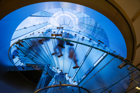 view of a staircase in a shop: Modern Glass Staircase Silhouette of walking People in shanghai china