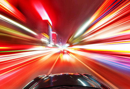 A car driving on a motorway at high speeds, overtaking other cars Archivio Fotografico
