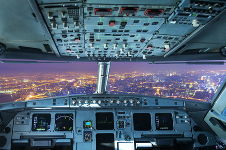 plane cockpit and the city of night