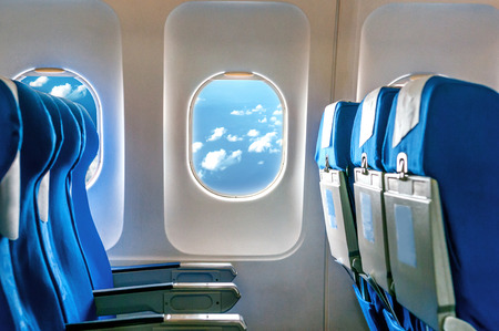 Empty aircraft seats and windows. Archivio Fotografico