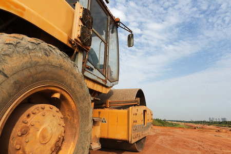 heavy equipment operator: Large road-roller paving a road. Road construction