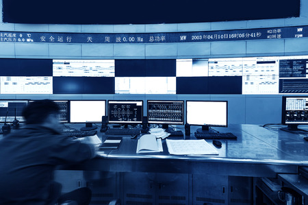 Modern plant control room and computer monitors Stockfoto
