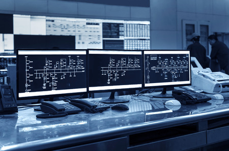 Modern plant control room and computer monitors Archivio Fotografico