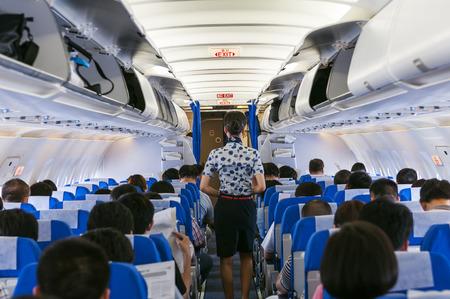 flight crew: beautiful flight attendant on board of big plane Stock Photo