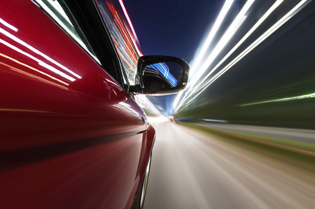 sports car: car on the road with motion blur background.
