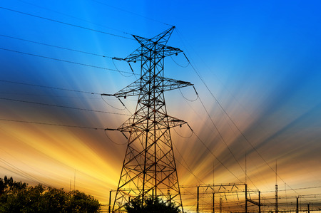power distribution: high voltage post.High-voltage tower sky background.