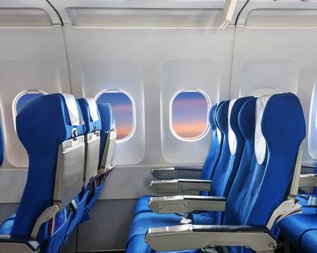 steward: Empty aircraft seats and windows. Stock Photo