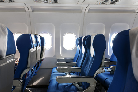 Empty aircraft seats and windows. Banque d'images