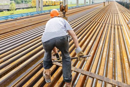 metallurgist: worker working in Steel pipes on the rack