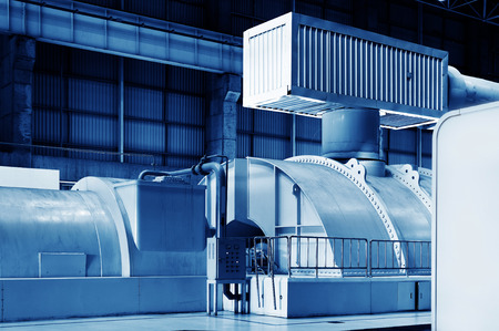 condensing: Modern boiler room equipment for heating system. Pipelines, water pump, valves, manometers. Stock Photo