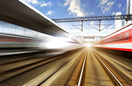 speed: two modern high speed train with motion blur