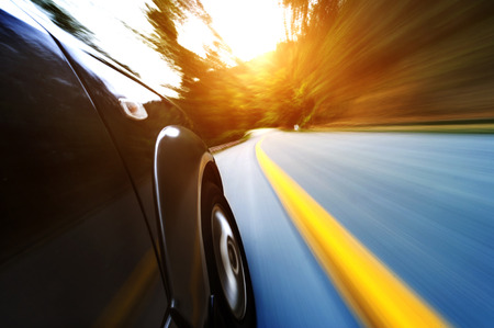 zoom: car on the road with motion blur background.