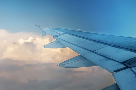 going places: Looking out the window of a plane