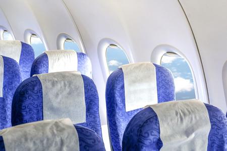 Empty aircraft seats and windows. Stockfoto