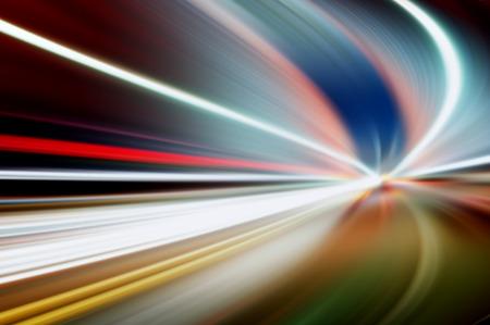 race car driver: motion blur of lights background.