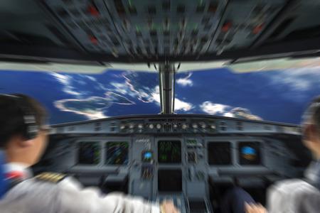 piloto: Los pilotos en la cabina de avi�n Foto de archivo