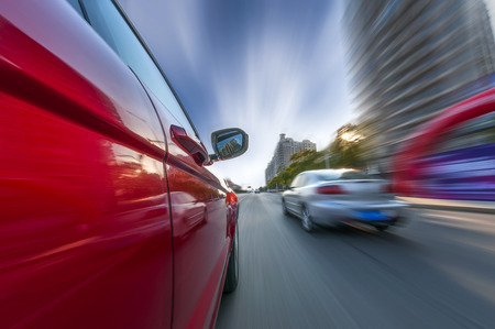 car on the road with motion blur background Standard-Bild