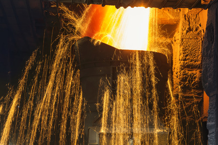 steelworks: Liquid iron from ladle in the steelworks