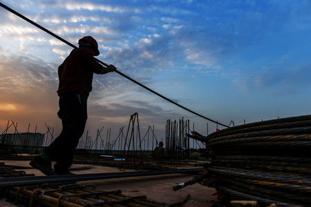 group of workers: construction worker on construction site Stock Photo