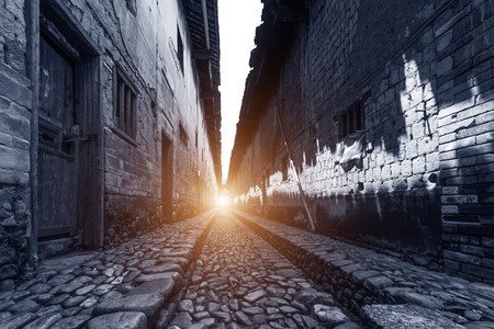 old street: Narrow stone street in the old  Chinese house Stock Photo