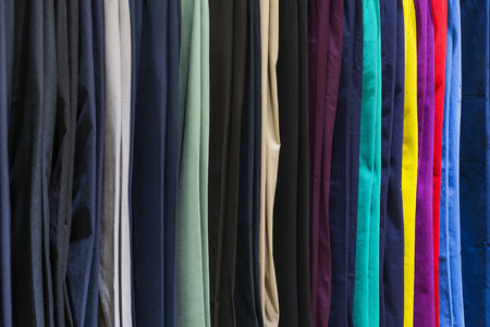 folded: Stack of casual cotton mens trousers