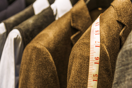 strip shirt: Row of men suit jackets on hangers
