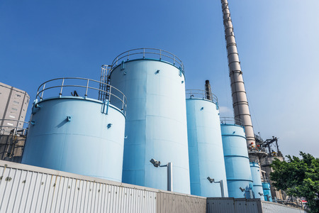 distillery: Industrial plant with blue sky Stock Photo