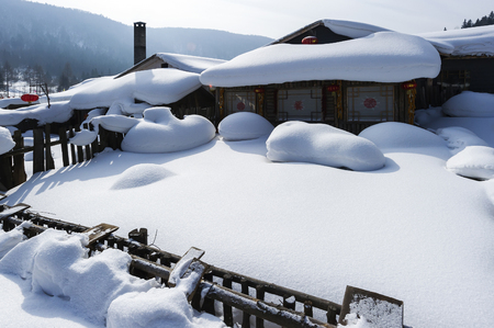 snowscape: Chinese characteristic farmhouse snowscape Stock Photo
