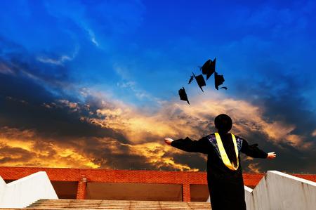 graduating seniors: pretty graduate throwing graduation hats in the air.