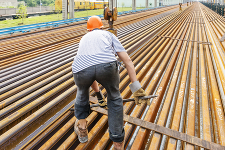mountings: worker working in Steel pipes on the rack