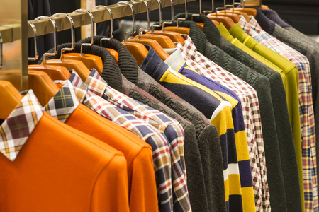 men's clothing: Row of mens clothing on hangers