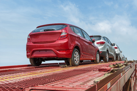 a lot: New auto cars under wraps being delivered on truck