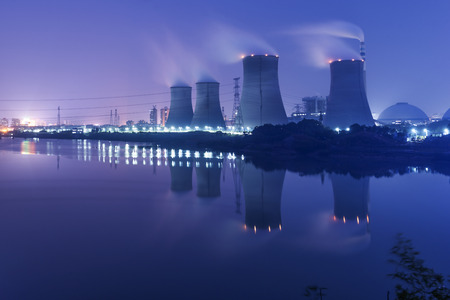 tops of cooling towers of atomic power plant  Stock Photo