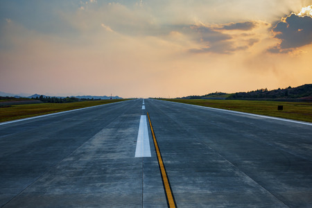 Runway  with marking under blue sky with clouds background. Travel aviation concept. Фото со стока - 106145946
