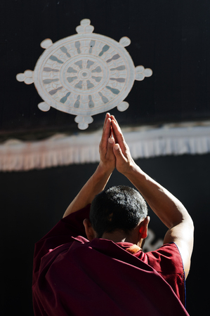 the lama praying in front of Jokhang Temple in Lhasa