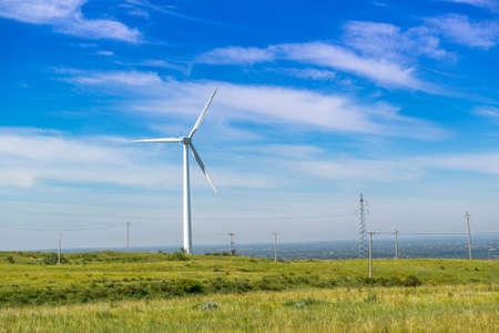 Wind turbine against the blue sky