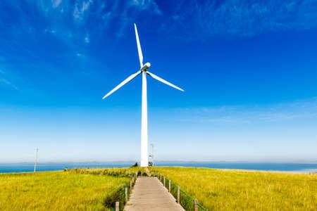 Wind turbine against wood bridge