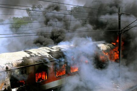 Six coaches of two premium trains � the Bhubaneshwar and Sealdah Rajdhanis � parked in the yard at New Delhi railway station were gutted in a fire on TuesdayPHOTO BY---VIPIN