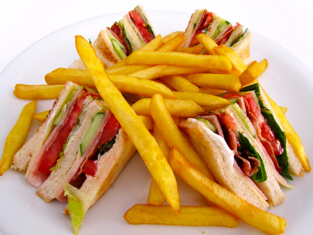 Club Sandwich with fries Stock Photo