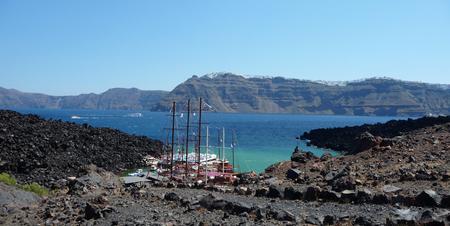 Sailing boats at Nea Kameni, volcanic island near Santorini, Greece