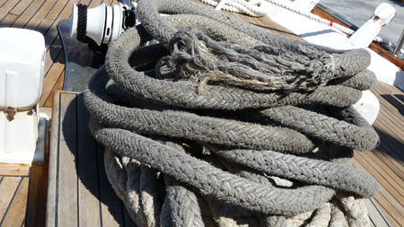 Black rope on a sail boat Stock Photo