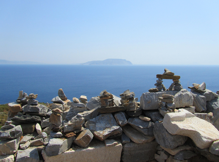 Homerâ € ™ s tomb in Ios with Irakleia island, blue sea and sky in the background, in Cyclades, Greece.