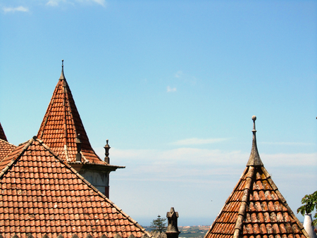 Pointed roofs with blue sky