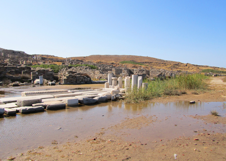 uninhabited: Ruins of a white temple in Delos island, Cyclades archipelago, Greece.