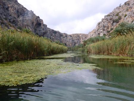 Preveli Lagoon with palms in a raining day, Crete, Greece