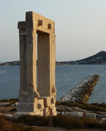 Portara, Apollo Temples entrance, Naxos, Greece. The island and sea in the background. Stock Photo