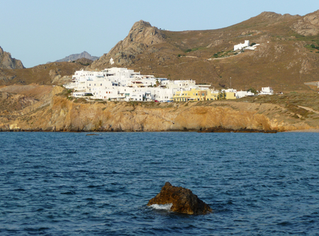 A traditional white village of Cyclades islands view from sea, Greece
