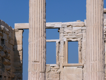 Old Greek classical ruins with blue sky. Suitable to be used like a background.