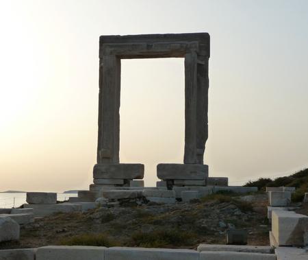 Portara, Apollo Temples entrance, at sunset. Naxos island, Greece Stock Photo